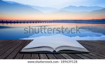 Book concept Double exposure effect of mountains and sunrise beach landscape - stock photo