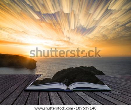 Book concept Unique time lapse stack sunrise landscape over rocky coastline - stock photo