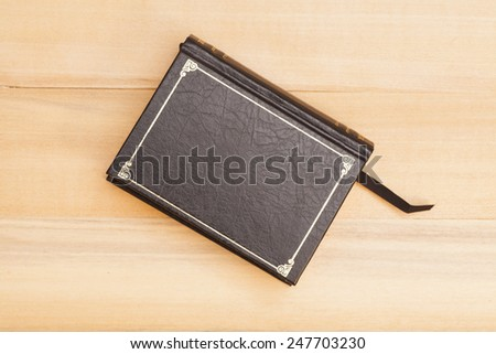 Book cover on wooden background - stock photo