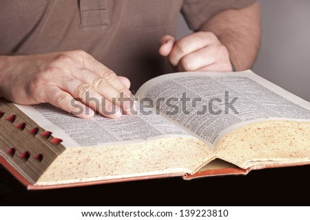 Book (Dictionary) with hands
