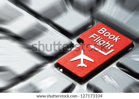 Book flight button on the computer keyboard - stock photo