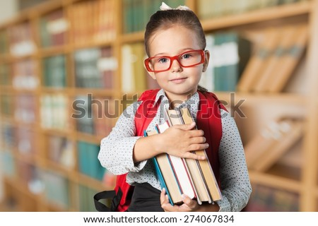 Book. Little student holding books - stock photo