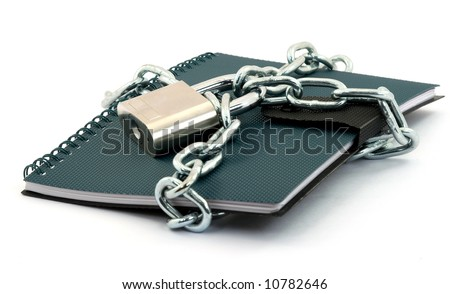 book locked with padlock and chains