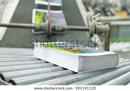 Book, magazine,  production line into press plant house. Automatic assembly line close up - stock photo
