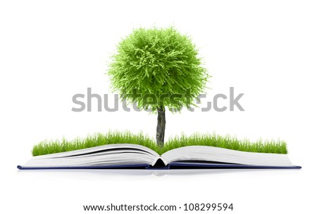 book of nature with grass and tree growth on it isolated on white background - stock photo