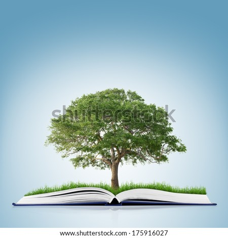 book of nature with grass and tree growth on it over white blue background