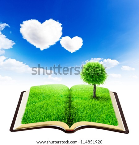 book of nature with grass and tree over beauty sky background with heart clouds