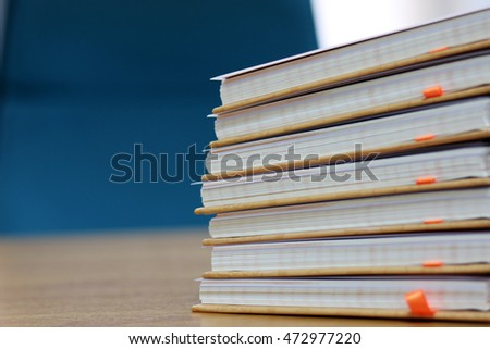 Book  on a table at a businessman in office