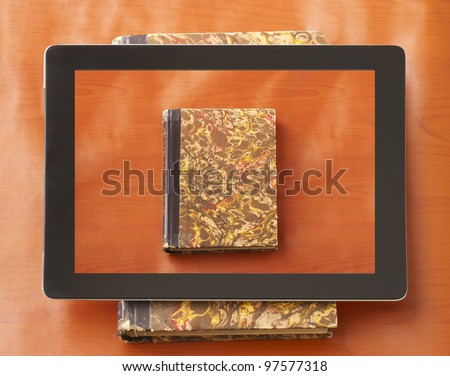 Book on a tablet over a book - stock photo