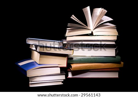 Book on black background. - stock photo