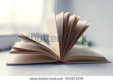 Book on blurred bokeh background