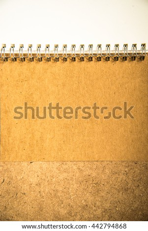 Book on brown wood - stock photo
