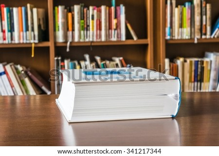 Book on the table in the library - stock photo