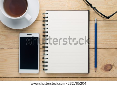 Book on the wooden table - stock photo