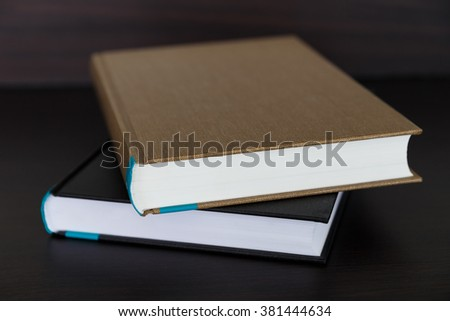 Book on wood desk. - stock photo