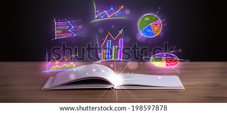 Book on wooden deck with glowing graph illustrations and symbols - stock photo