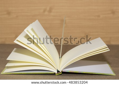book open on wooden desk
