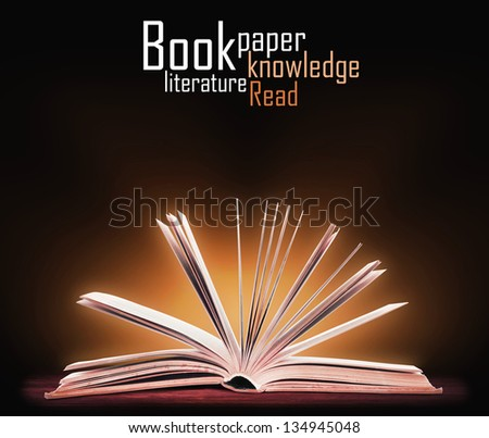 Book. Opened book with special light. Education - stock photo