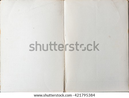 Book opened to the first page showing blank pages inside. - stock photo