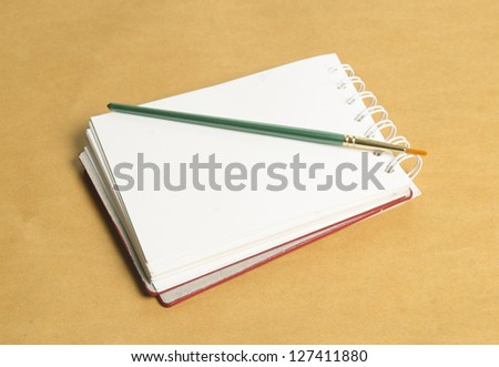 book or notebook on brown vintage background
