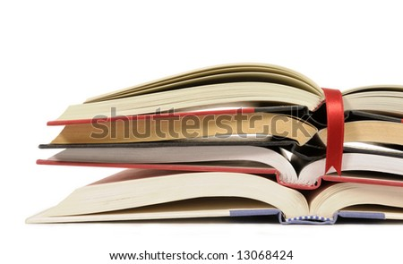 Book pile : small stack or pile of open books with bookmark ribbon isolated on white background. - stock photo