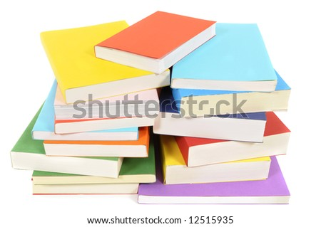 Book pile : untidy pile or stack of colorful paperback books isolated on white background.