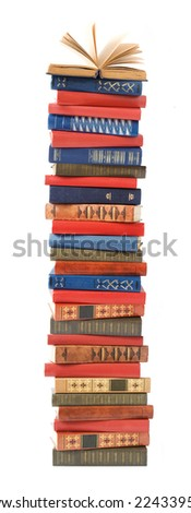 Book pile with open book on top isolated on white background - stock photo