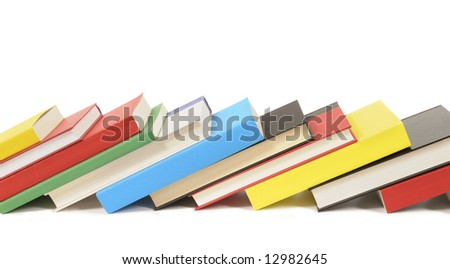 Book row : leaning row of colorful books isolated on white background.  Space for copy. - stock photo