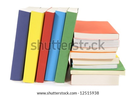 Book row : set of colorful paperback books isolated on white background.