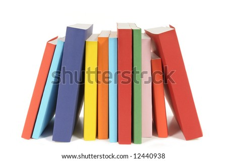 Book row : untidy row of colorful paperback books isolated on white background. - stock photo
