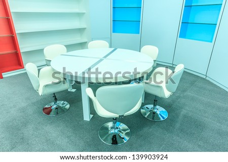 book shelf, white chair and tables set for reading in the empty library - stock photo