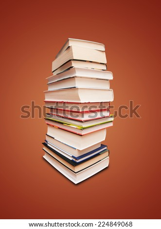 book stack isolated on brown background