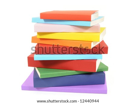 Book stack : untidy pile of colorful paperback books set isolated on white background.