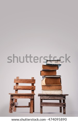 Book stacking on the table. Back to school. Grey background. Copy space.