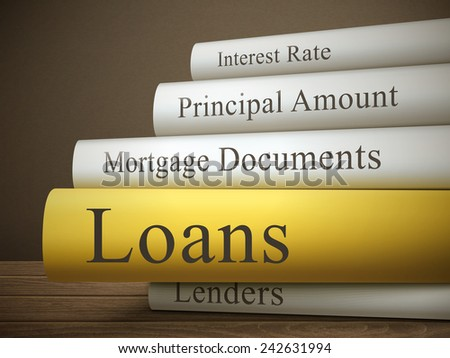 book title of loans isolated on a wooden table over dark background - stock photo
