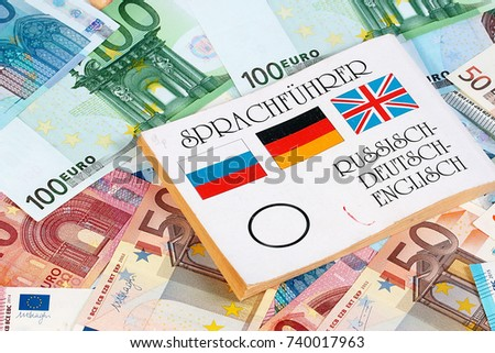 book translator lies on paper euro banknotes