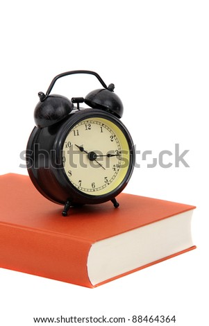 book with alarm bell on white