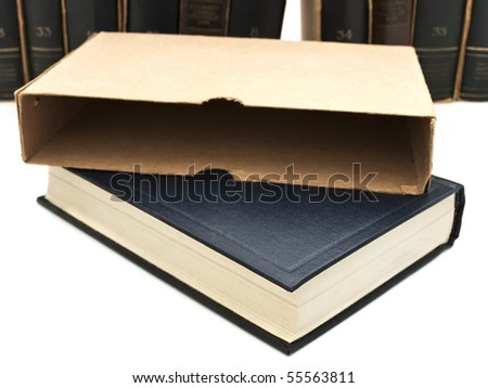 book with box over bookshelf - stock photo