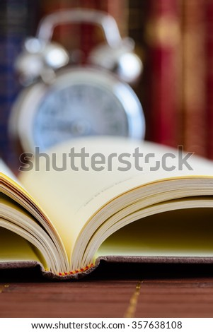 Book with clock on background