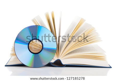 Book with compact disc over white background - e-book or digital storage concept - stock photo