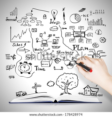 Book with drawing business sketches background - stock photo