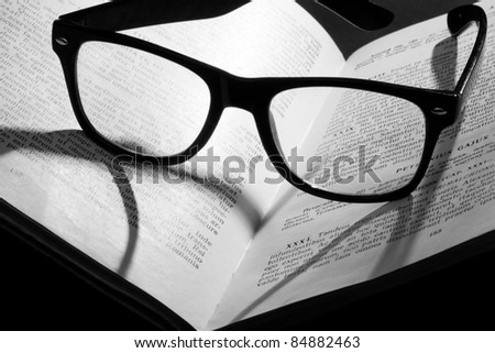 Book with glasses - stock photo