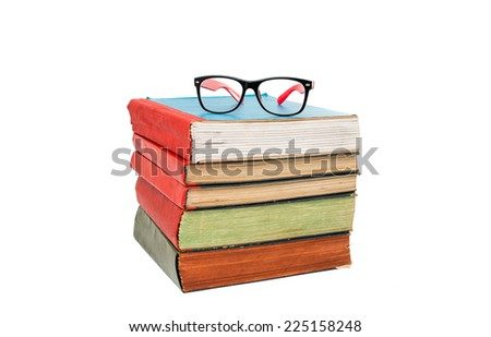 book with glasses on white background - stock photo