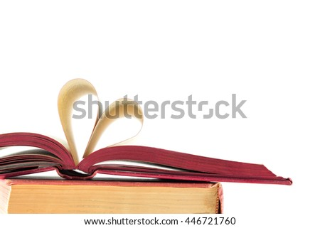Book with opened pages and shape of heart isolate on white background - stock photo