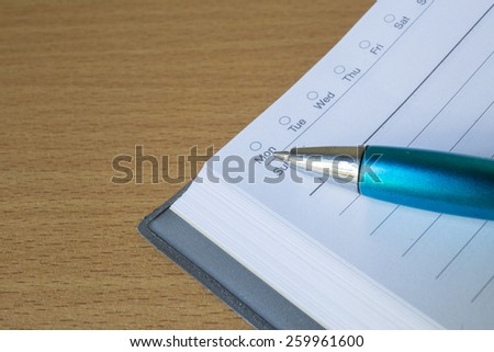 book with pen point to monday - stock photo