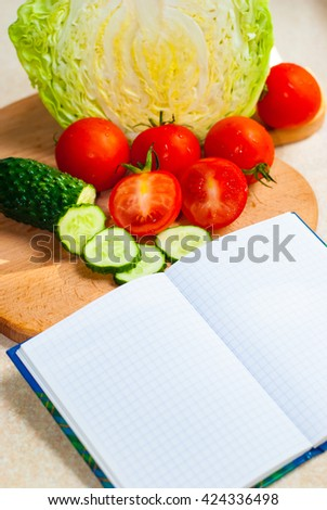 Book with vegetable recipes - stock photo