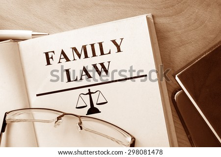 Book with words family law and glasses. - stock photo