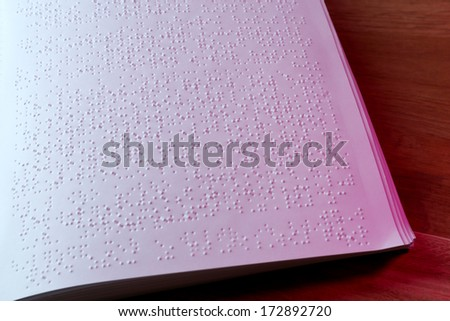 Book written in braille alphabet for blind people - stock photo