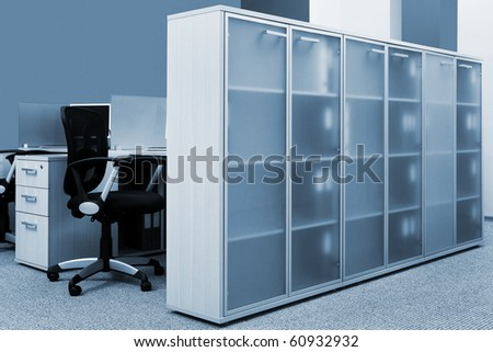bookcase with folders in a modern office - stock photo