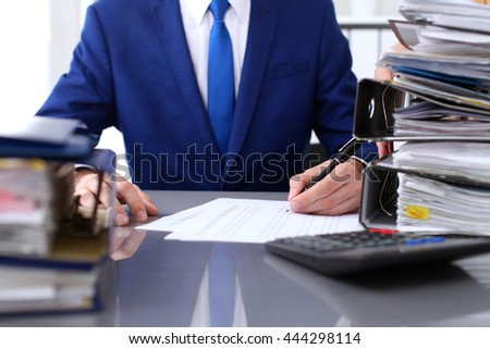 Bookkeeper or financial inspector and secretary making report, calculating or checking balance. Audit concept.  - stock photo